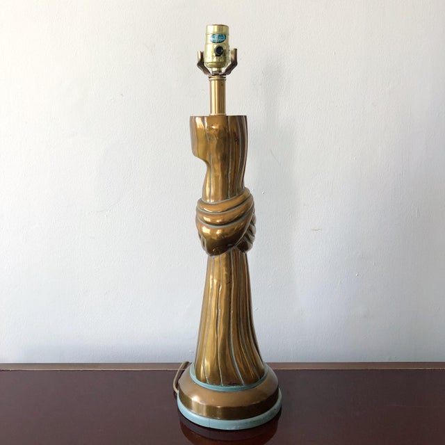 Unusual vintage draped bronze lamp with knot on Tiffany blue painted wood base. In the John Dickinson Style. Shade not...