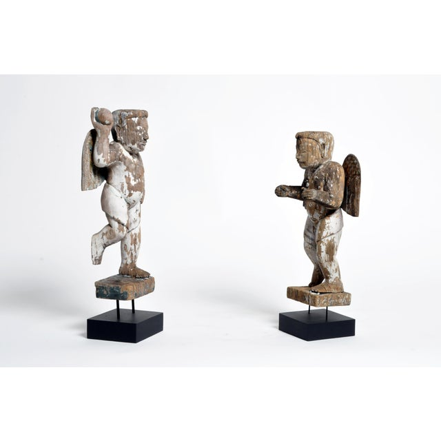 These beautiful wooden cupids are from Chiang Mai, Thailand and made from teak wood c. 1980. 2 of each available; price is...