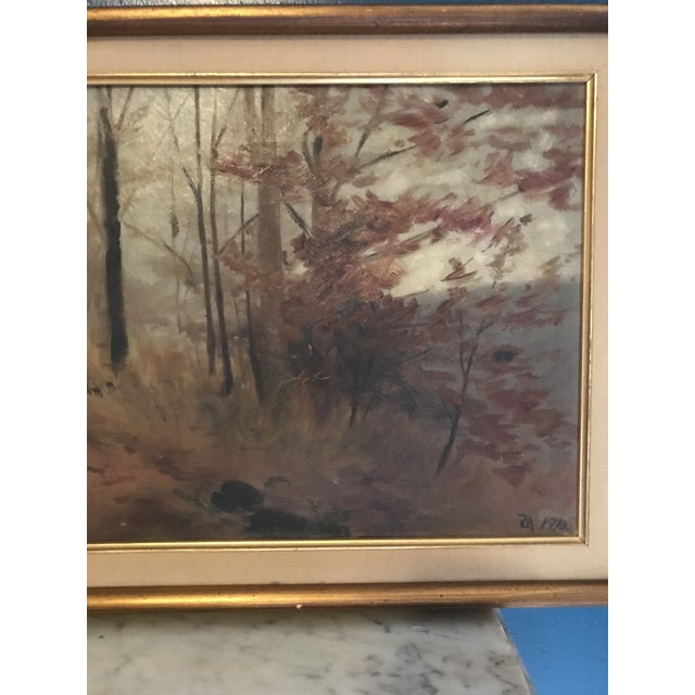 This beautiful fall landscape is painted in oil and depicts a gorgeous woodland scene. It is signed ZM with the date 1910...