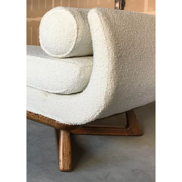 Rare opportunity for a stunning piece by Paul Laszlo for Brown Saltman chaise lounge. Re-upholstered in ivory boucle by...