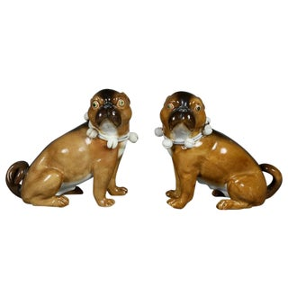 Pair of German Porcelain Figures of Seated Pugs For Sale