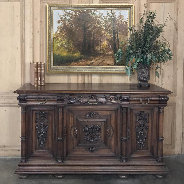 19th Century French Walnut Henri II Buffet features carved embellishment influenced by the Renaissance and Baroque styles....