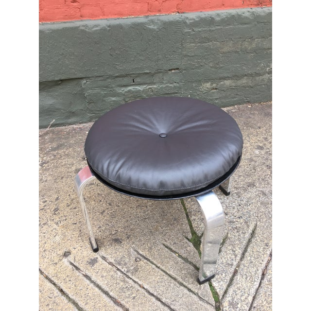 In the Style of Poul Kjaerholm Stool. Newly upholstered in a dark brown leather. Stainless Steel Legs with black Rubber...