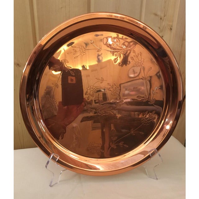 Great looking mid-century round copper tray with pretty embossed Floral design. A few scratches on the face.