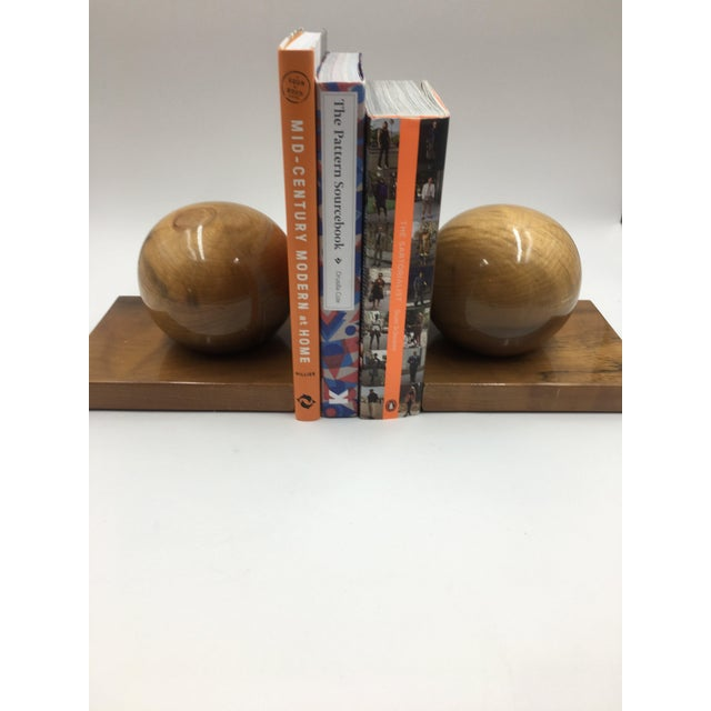 Very cool pair of wood bookends with a high gloss finish. Features a large ball on a wooden base. Has the feeling of Art...