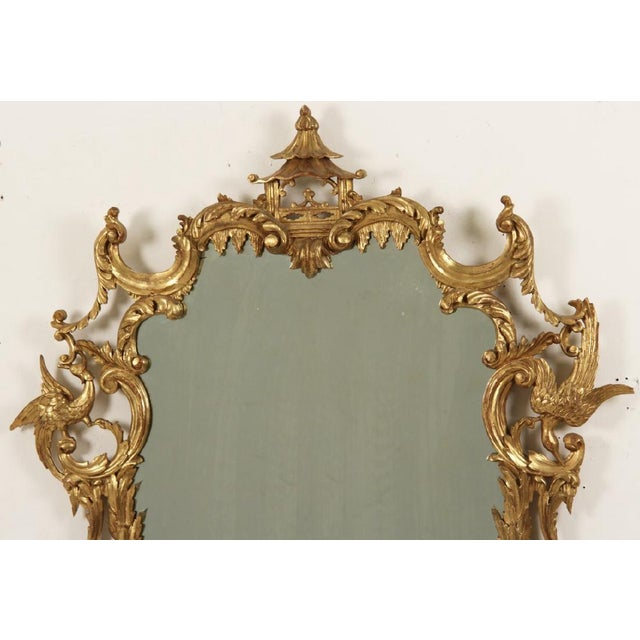 "Chinese Chippendale Chinoiserie style giltwood mirror with Pagoda top frame of rocaille influence. details include ""C""..."