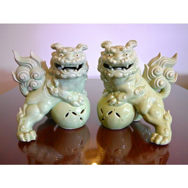 Porcelain Japanese Foo Dogs in exquisite celadon. Wonderful detail and in excellent cosmetic condition with no chips,...