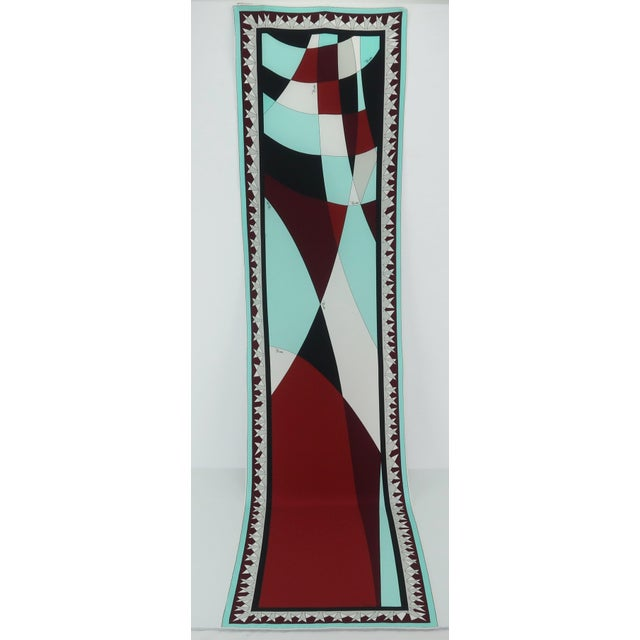The combination of rich colors and a psychedelic print makes this Emilio Pucci extra long silk scarf the perfect accessory...
