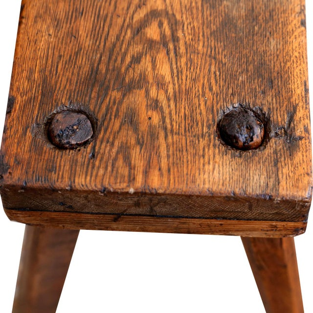 Primitive English oak bench dating to the early 19th century (circa 1800-1820). Thick, very heavy plank seat bench...