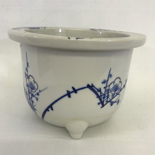 Vintage footed Chinese blue and white porcelain flower pot or cachepot with hand painted decoration including cherry...