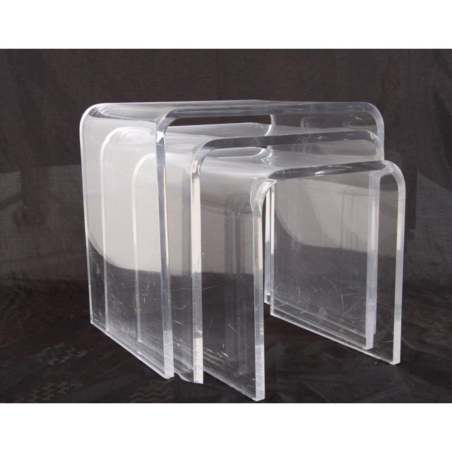 Fantastic set of heavy well made lucite nesting tables by renowned lucite sculptor Shlomi Haziza. The middle table is...