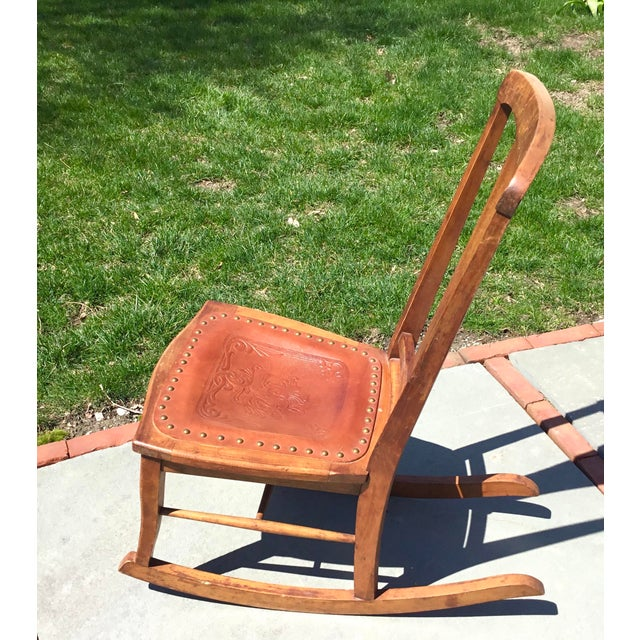 """Solid wood and very sturdy rocking chair. Label states """"B C CO, NY City NY"""". Old cane seat replaced mid 1900s with saddle..."""