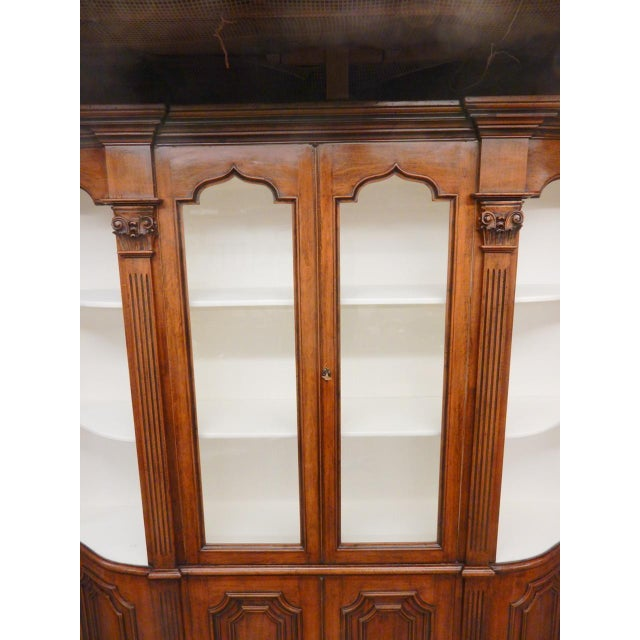 High quality late 19th century Italian walnut bookcase cabinet. It is long and slender. Top comes apart in 3 interlocking...