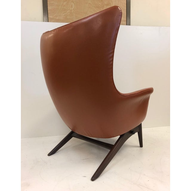 Reclining lounge chair by H.W. Klein. The chair has a teak frame, 1960s and has a tilt reclining mechanism.