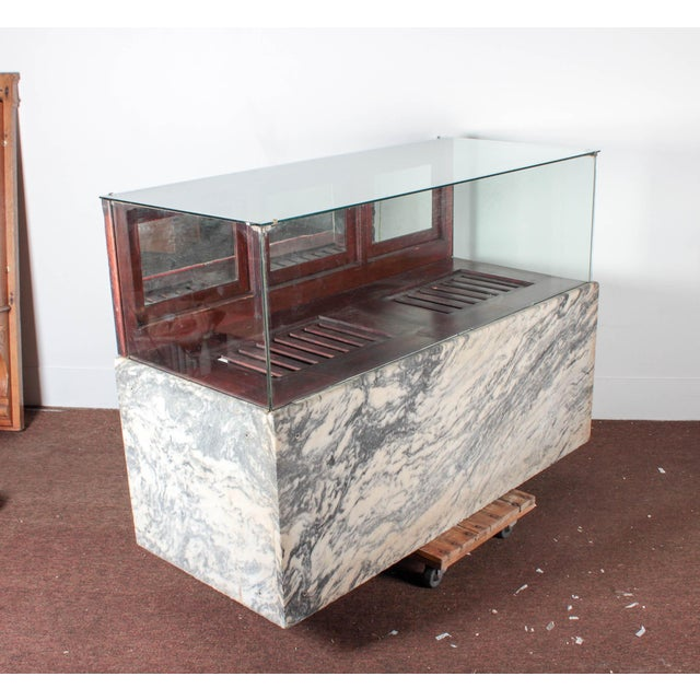 """Antique marble & glass showcase by Wilmarth Co, Grand Rapids, MI. Measures 60"""" wide, 42"""" tall and 26"""" deep. All original..."""
