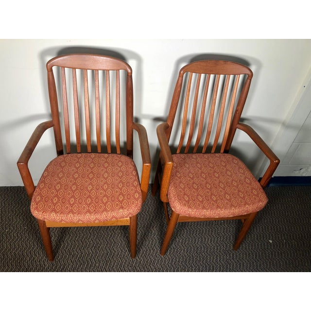 Beautiful set of 8 teak dining chairs by Benny Linden with slatted back. Including two with arms. Fantastic condition. All...