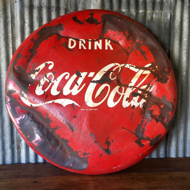 """Vintage original """"Drink Coca-Cola"""" round metal button sign circa 1950s. Porcelain painted and professionally sealed to..."""