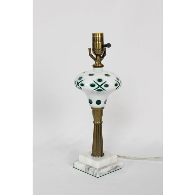 Green and White Overlay Glass Lamp. Glass font, with a brass column stem and marble base. Bohemian Glass brought back...