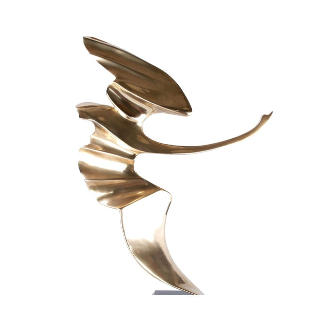Mid Century bronze abstract bird sculpture on a wood base by Hattakitkosol Somchai (1934-2000). Marked and dated by...