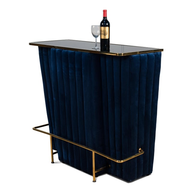 Viewed from the front, this bar has an inviting look. Channel quilted velvet and a gold-tone foot rest. The back gives all...