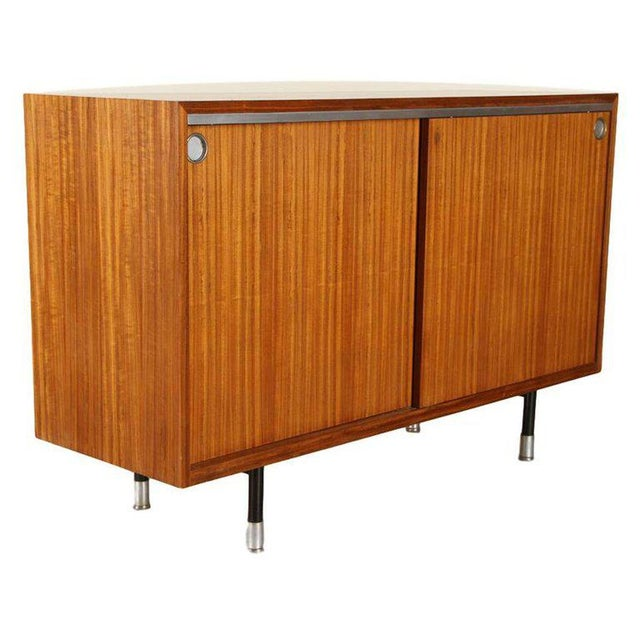 Rosewood sideboard/cabinet with two sliding doors and aluminum fittings by George Nelson for Herman Miller, circa 1968....