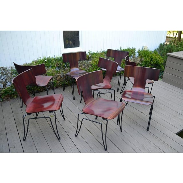 "Set of eight klismos style ""Anziano"" dining chairs by John Hutton for Donghia. Moulded beechwood veneer atop of black..."