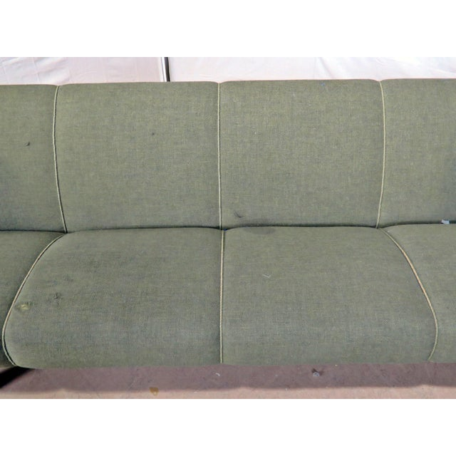 Vintage Mid-Century Modern Sofa with piping to the upholstery.