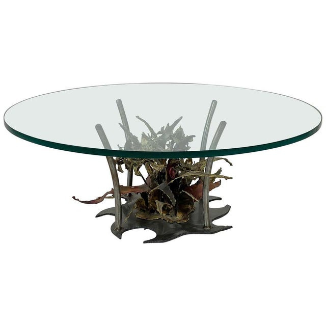 """Highly striking welded coffee table signed by Silas Seandal with a heart and dated 1975. Glass top is 42"""" round Base..."""