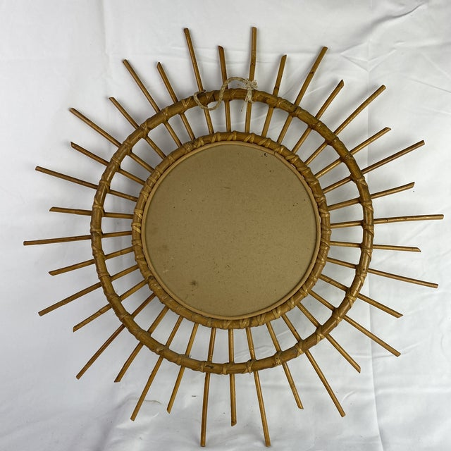 French mid-century bamboo starburst mirror. Hanging hardware on back.