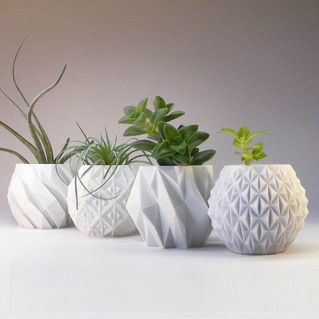A set of 4 small geometric planters, suitable for desks, shelves, mantels or office spaces. Enjoy the decorative effect of...