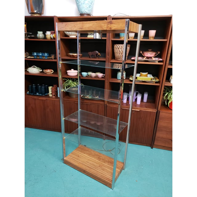 Mid Century Wood & Glass Etagere. It is a lighted unit, circa 1960. Has a classic modern minimalism with an elegant form...