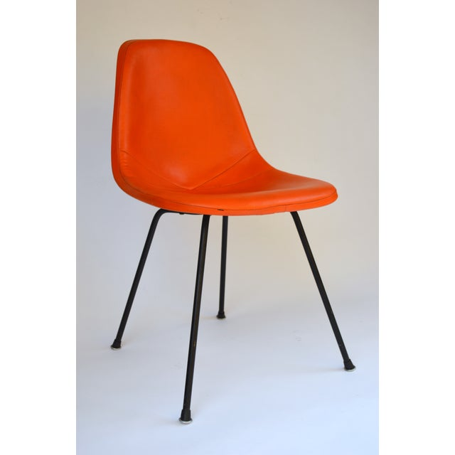 Beautiful orange vinyl Herman Miller Eames side shell chair! This is an early Eames Original fiberglass chair with the...