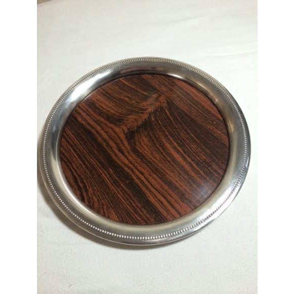 Very cool mid century Sheffield Silver round tray. Lovely beaded polished aluminum edge and Formica Brand faux wood...