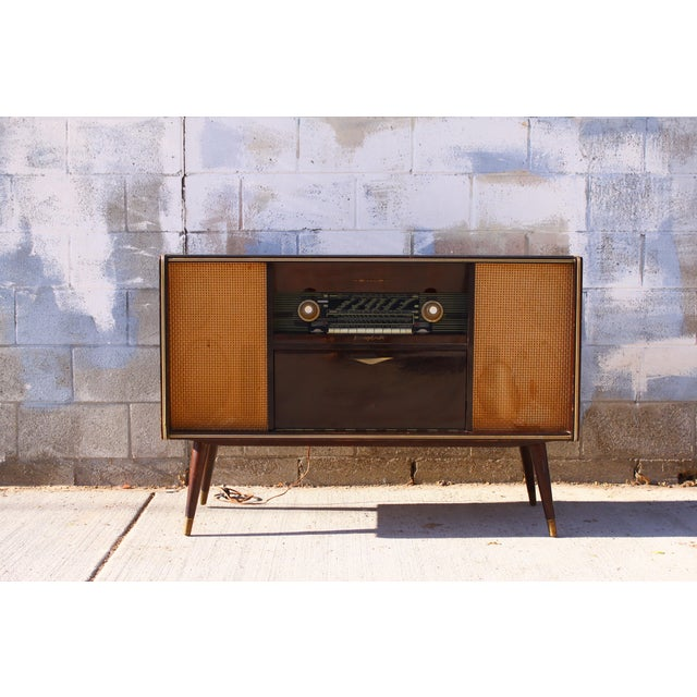 A terrific mid century modern German Emud Stereo Console. This is a super unique design with cool lines and funky mid...