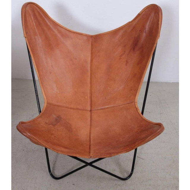 Butterfly chair pair by Knoll International with exceptionally beautiful original leather in cognac on a black base....