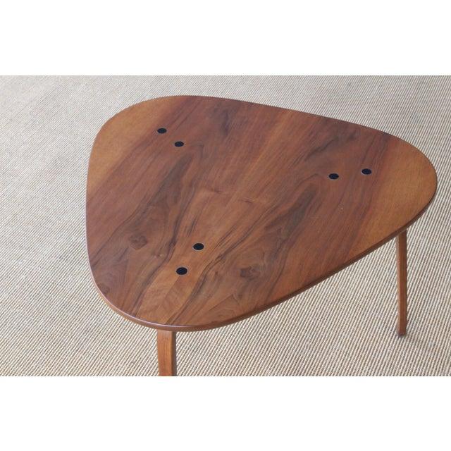 Teak side table designed by Yngve Ekstrom in Sweden in the 1950s. Recently refinished.
