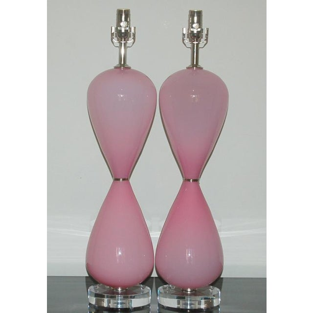 Sexy figure eights of glossy PINK OPALINE, joined at the waist by a pair of nickel wafers. Tall and statuesque! The lamps...