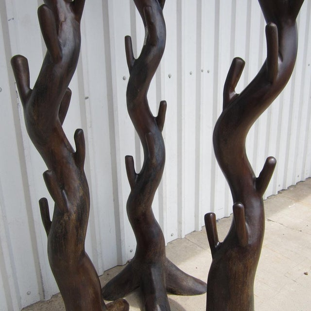A vintage mid century hall tree sculpture. This hall tree sculpture is a stylish yet functional addition for entrance...