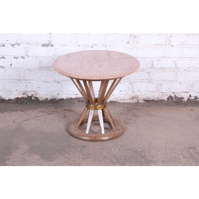 A gorgeous mid-century modern sheaf of white side table in the manner of Edward Wormley for Dunbar . The table features a...