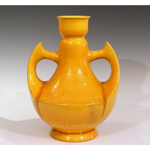 """Awaji Pottery vase with large curved wing handles and warm yellow monochrome glaze, circa 1920s. Measures: 14 1/4"""" high,..."""