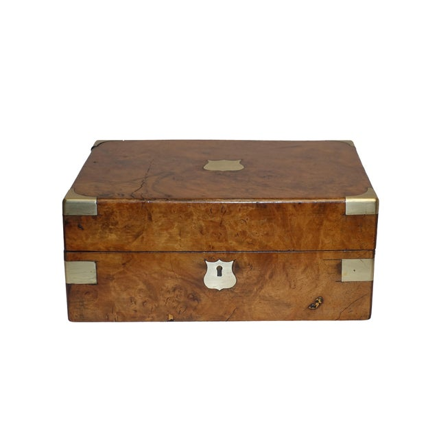 A handsome Campaign style burl walnut box with brass accents and marbleized paper on the interior. England, circa 1870.