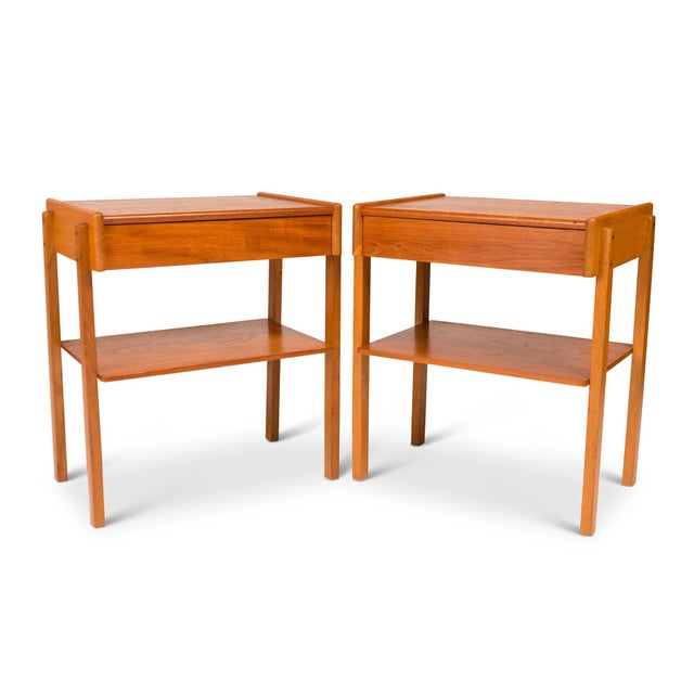 With a sleek minimal design of these vintage Danish Mid-century are make out of teak and oak. Each nightstand has a pull...
