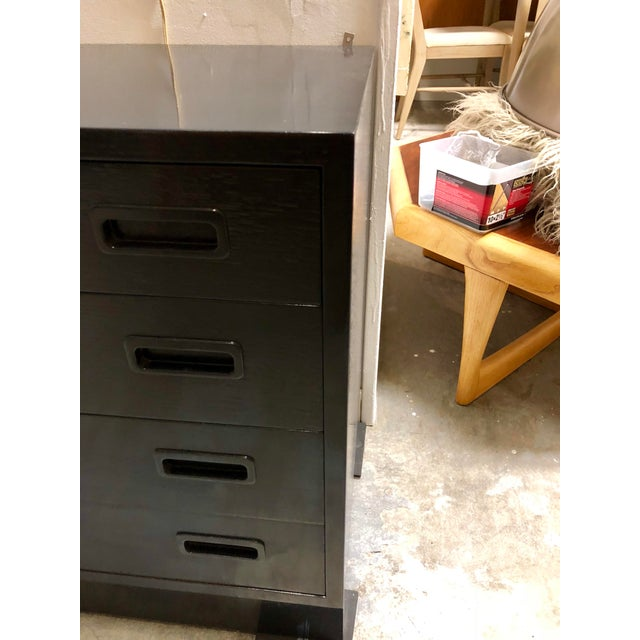 Bland new black lacquer on a mid century teak Danish cabinet. High gloss, high style, and tons of storage!
