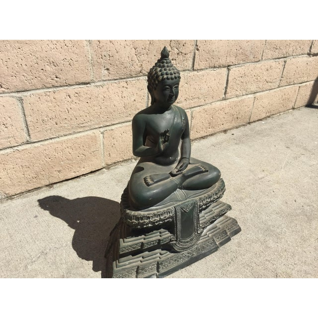 This reproduction Chiang Saen Buddha is made of bronze. The Chiang Saen period was from 13th to 18th century. It was...