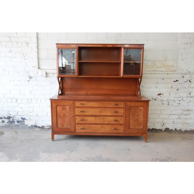 Offering an outstanding mid-century modern sideboard credenza with hutch top designed by Renzo Rutili for Johnson...