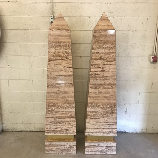 Really unusually large obelisks that are covered in faux travertine laminate material over pressed wood. A couple small...