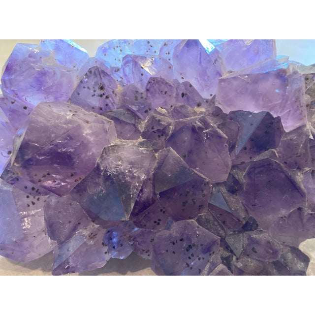 Selling my old amethyst. Been in the family for 20+ years. Large cut stones and in great condition. Weighs roughly 9lbs.