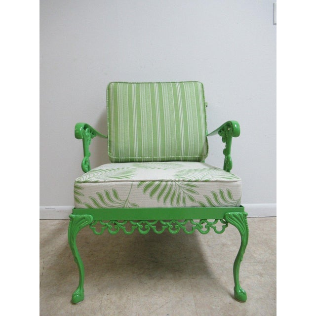 """A vintage green aluminum Chippendale ball and claw patio chair. Measurements ( L x W x H) 33 x 24 x 33 seat height 16"""" arm..."""