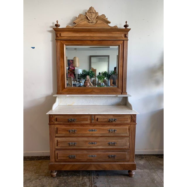 Beautiful and stately, this solid oak 19th Century Victorian-style dresser features five oak dovetailed drawers with...