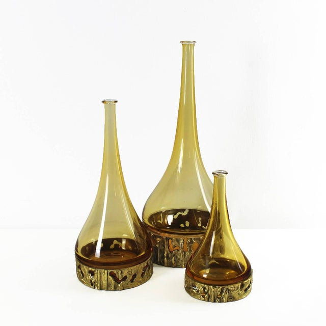 Set of three yellow Murano blown glass with a golden bronze base including the signature. Designer: Angelo Brotto. Italy,...